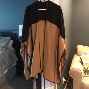 Tan and black sweater poncho